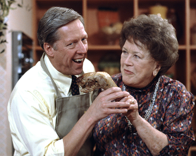 """GOOD MORNING AMERICA - 11/27/85 Julia Child tempted David Hartman during her Thanksgiving dinner preparations on """"Good Morning America"""", 11/27/85. """"Good Morning America"""" airs Monday-Friday, 7-9 a.m., ET, on the ABC Television Network.    GM85 (ABC/Fred Watkins) DAVID HARTMAN, JULIA CHILD"""