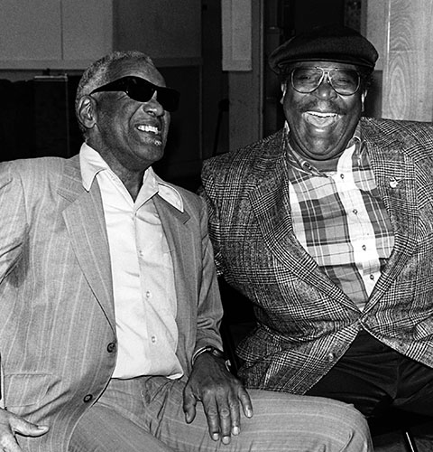 """Blues singers Ray Charles and B.B. King laugh during a press conference announcing their world tour. """"Ray's all right. Just don't play cards with him. He cheats,"""" King said. (Fred Watkins/EBONY Collection)"""
